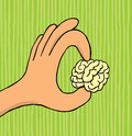 Hand holding tiny brain cartoon illustration of a a small Royalty Free Stock Photo