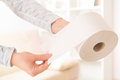 Hand holding toilet paper at home Stock Photos