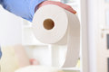 Hand holding toilet paper Royalty Free Stock Photo