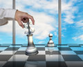 Hand holding usd symbol piece playing chess with pawn d on table and blue sky outside Stock Images
