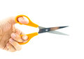 Hand holding used orange scissor isolated on white background Royalty Free Stock Photos