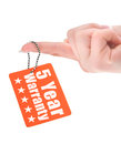 Hand holding warranty tag Royalty Free Stock Photos