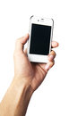 Hand holding white cell phone Royalty Free Stock Photo