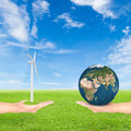 Hand holding wind turbine and earth Royalty Free Stock Photo