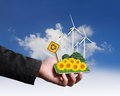Hand holding with wind turbines farm eco concept Stock Photo