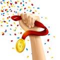 Hand holding winners medal award Royalty Free Stock Photo