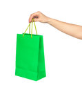 The hand holds a bright green bag for shopping Royalty Free Stock Photo