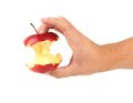 Hand holds core of an apple close up Royalty Free Stock Photo
