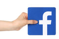 Hand holds facebook logo printed on paper on white background kiev ukraine april is a well known social networking Royalty Free Stock Photo