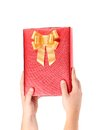 Hand holds gift box isolated on a white background Royalty Free Stock Photo