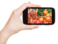 Hand holds handphone with Xmas still life Royalty Free Stock Photo