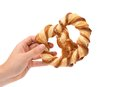 Hand holds knot shaped biscuits on a white background Royalty Free Stock Photography