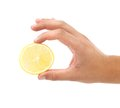 Hand holds lemon slice close up white background Royalty Free Stock Image