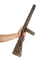 Hand holds wooden toy mashine gun Royalty Free Stock Photo