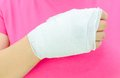 Hand injury with white medicine bandage Royalty Free Stock Images
