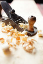 Hand jack plane and wood chips Royalty Free Stock Photos