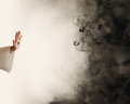 Hand of Jesus stopping darkness Royalty Free Stock Photo