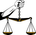 Hand of justice weighing scales Stock Photography