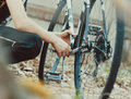 stock image of  Hand with key repairs broken bicycle