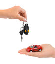 Hand with keys and car isolated on white background Royalty Free Stock Photos