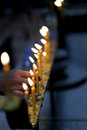 Hand that are kindle fire the candle on buddhist worship Stock Photography