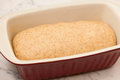 Hand kneaded dough for spelt bread rising in baking sheet. Royalty Free Stock Photo
