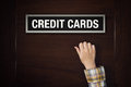 Hand is knocking on Credit Cards door Royalty Free Stock Photo