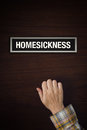 Hand is knocking on homesickness door male conceptual image Royalty Free Stock Images