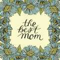 Hand lettering The best mom made on floral background with blue flowers.