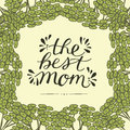 Hand lettering The best mom made on floral background.