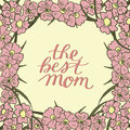 Hand lettering The best mom made on floral background with pink flowers.