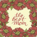 Hand lettering The best mom made on floral background with red flowers.