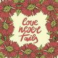Hand lettering Love never fails made with flowers.