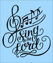 Hand lettering Sing to the Lord on a blue background with notes. Royalty Free Stock Photo