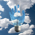 Hand light bulb with clouds Royalty Free Stock Photos
