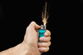 Hand with lighter igniting in blackground Royalty Free Stock Photography