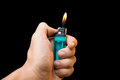 Hand with lighter igniting in blackground Stock Photo