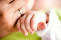 Hand of little baby boy holding his mothers hand Royalty Free Stock Photo