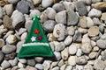 Hand made christmas decor on pebble stones close up shot of green triangular velvet grey Stock Image
