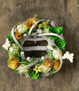 Hand Made Easter wreath with flowers and eggs Royalty Free Stock Photo