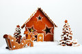 The hand made eatable gingerbread house and new year trees with snow decoration Stock Photos
