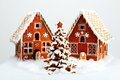 The hand made eatable gingerbread houses and new year tree with snow decoration Royalty Free Stock Photography