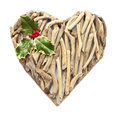 Hand-made ornamental heart made of dry sticks Stock Photography