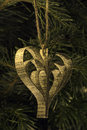 Hand made paper heart shape christmas toy on the tree Royalty Free Stock Images