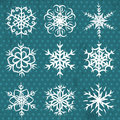 Hand made snowflakes on blue background, vector Stock Image
