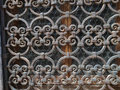 Hand made solid iron grille in the window Royalty Free Stock Photography