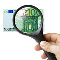 Hand magnifying glass banknote euro male holding a over isolated on white background Stock Photo