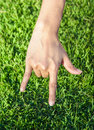 Hand make symbol of love by hand young girl on grass background Royalty Free Stock Image