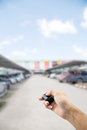 Hand male asia ,holding car remote on Abstract blur background o Royalty Free Stock Photo