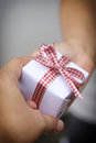 Hand of man giving a gift box. Royalty Free Stock Photo